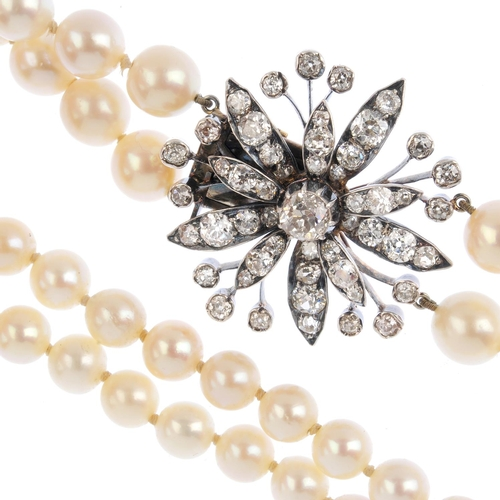 218 - A cultured pearl and diamond choker. Comprising two graduated cultured pearl strands, to the late 19...