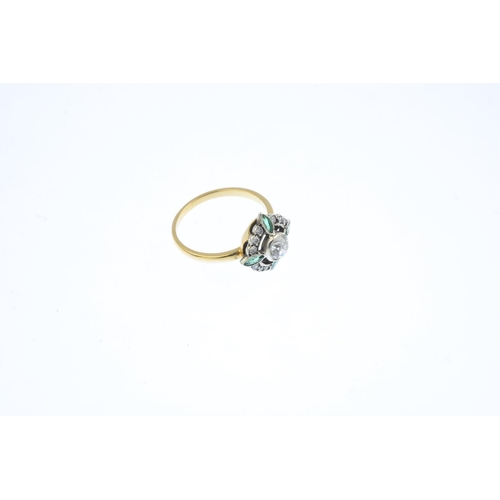 219 - A diamond and emerald ring. The old-cut diamond, within a marquise-shape emerald cross and brilliant...