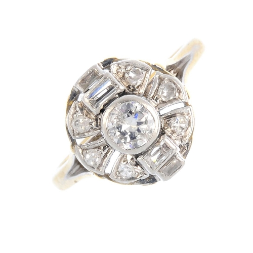 22 - A diamond cluster ring. The brilliant-cut diamond, with baguette-cut diamond sides and single-cut di...