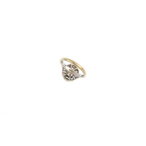 22 - A diamond cluster ring. The brilliant-cut diamond, with baguette-cut diamond sides and single-cut di...