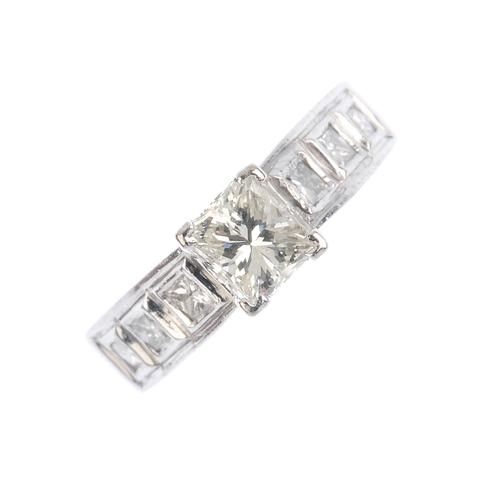 220 - An 18ct gold diamond single-stone ring. The square-shape diamond, with similarly-cut diamond panel s...