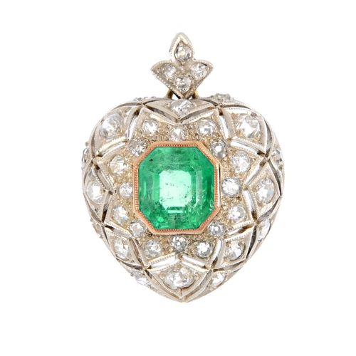 222 - A Colombian emerald and diamond heart pendant. The octagonal-shape emerald, weighing 5.48cts, with o...