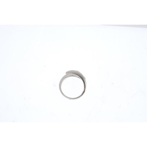 227 - A diamond single-stone ring.  The brilliant-cut diamond, with asymmetric shoulders. Estimated diamon...