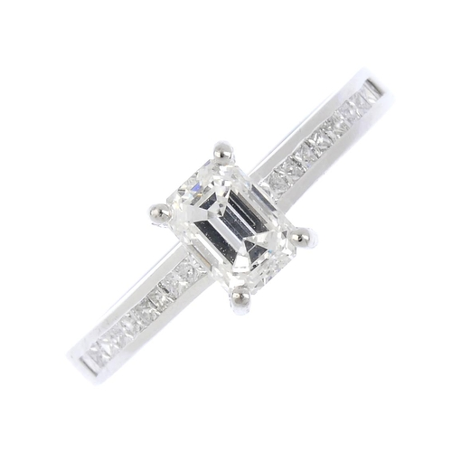 229 - An 18ct gold diamond single-stone ring. The rectangular-shape diamond, weighing 0.82ct, with square-...