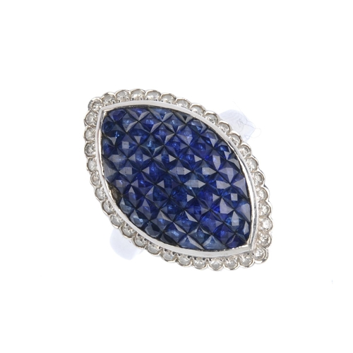230 - A sapphire and diamond dress ring. The calibre-cut sapphire marquise-shape panel, within brilliant-c...