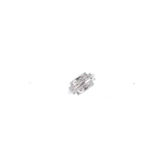 232 - A diamond dress ring. The brilliant-cut diamond line, with similarly-cut diamond sides and stepped t...