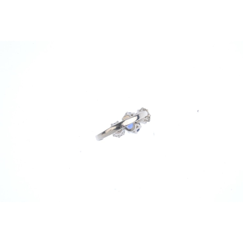 234 - A sapphire and diamond three-stone ring. The oval-shape sapphire, with old-cut diamond sides and tap...