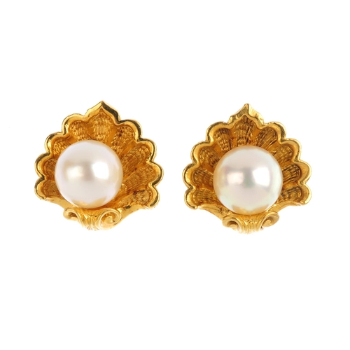 236 - GARRARD - a pair of 18ct gold cultured pearl earrings. Each designed as a cultured pearl, within a h...
