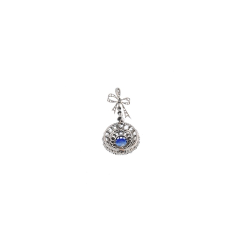 240 - A sapphire and diamond pendant. The cushion-shape sapphire and old-cut diamond graduated surrounds, ...