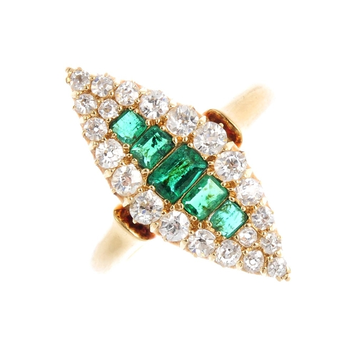 25 - An Edwardian 18ct gold emerald and diamond cluster ring. Of marquise-shape outline, the graduated re...