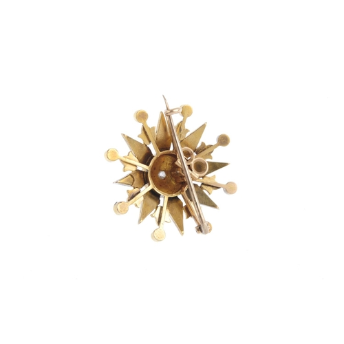 250 - An early 20th century gold split pearl and diamond star brooch. The old-cut diamond and split pearl ...