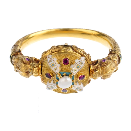 254 - A mid Victorian gold natural pearl, enamel and gem-set hinged bangle, circa 1860. Comprising twin my...