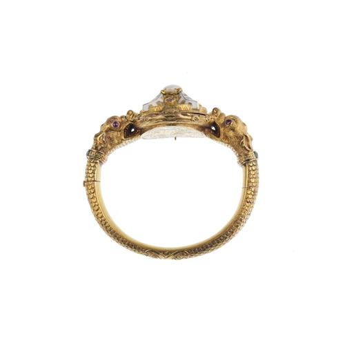 254 - A mid Victorian gold natural pearl, enamel and gem-set hinged bangle, circa 1860. Comprising twin my...