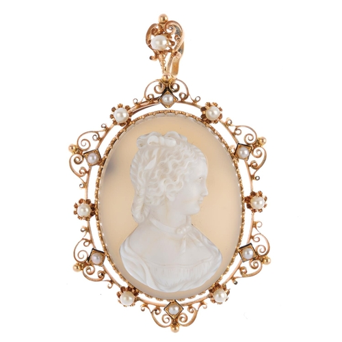 256 - A mid 19th century gold hardstone cameo and seed pearl pendant. The hardstone cameo, carved to depic...