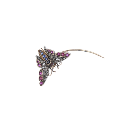 259 - A late Victorian silver and gold diamond and gem-set butterfly brooch. With circular-shape sapphire ...