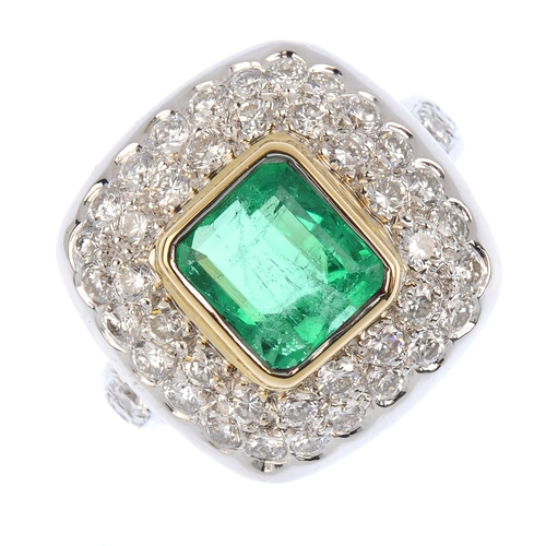 261 - A Colombian emerald and diamond dress ring. The rectangular-shape emerald, with brilliant-cut diamon...