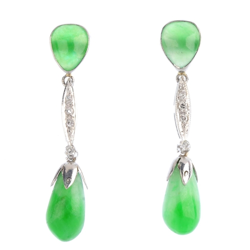 262 - A pair of jade and diamond earrings. Each designed as a jadeite drop, suspended from a pear-shape ja...