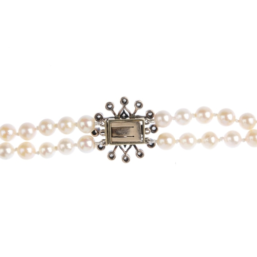 263 - A cultured pearl two-row necklace. Comprising two rows of forty-eight and forty-five cultured pearls...