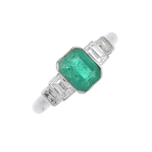 265 - A Colombian emerald and diamond ring. The rectangular-shape emerald, weighing 0.86ct, with baguette-...