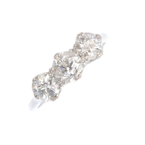 266 - A diamond three-stone ring. The slightly graduated old-cut diamond line, with openwork gallery and p...