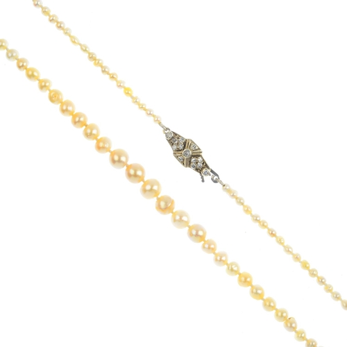 27 - A natural pearl single-strand and diamond necklace. Comprising a single-strand of 137 pearls, measur...