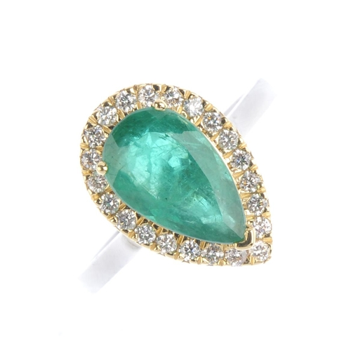 271 - An 18ct gold emerald and diamond ring. The pear-shape emerald, with brilliant-cut diamond surround. ...