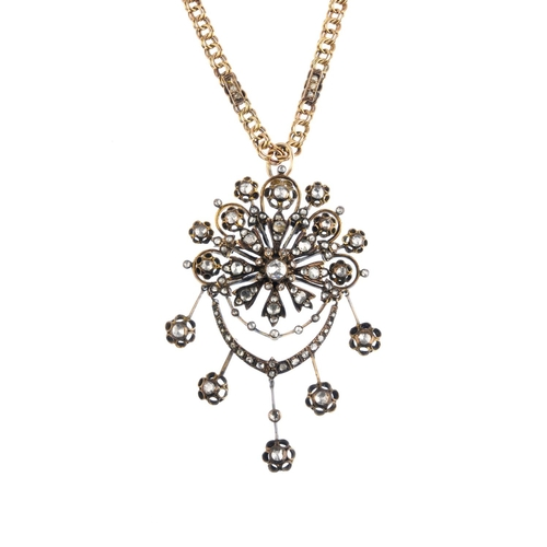 277 - A diamond pendant. The rose-cut diamond fringe, suspended from similarly-cut diamond swags and openw...