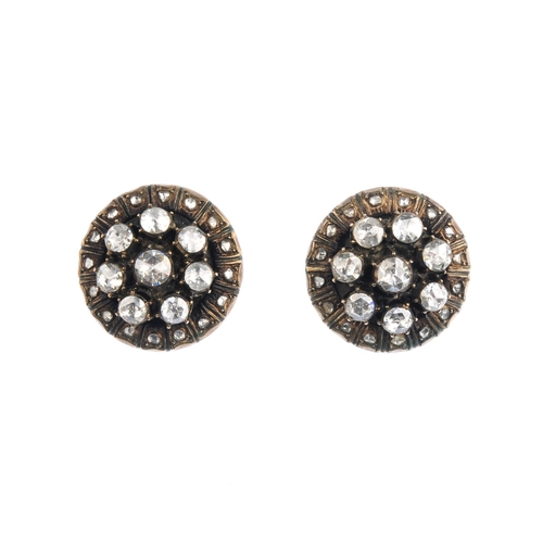 278 - A pair of diamond earrings.. Each of circular outline, the rose-cut diamond cluster, with similarly-...