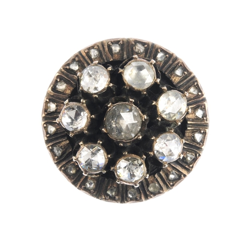 279 - A diamond dress ring. The rose-cut diamond collet cluster, with similarly-cut diamond surround. Ring...