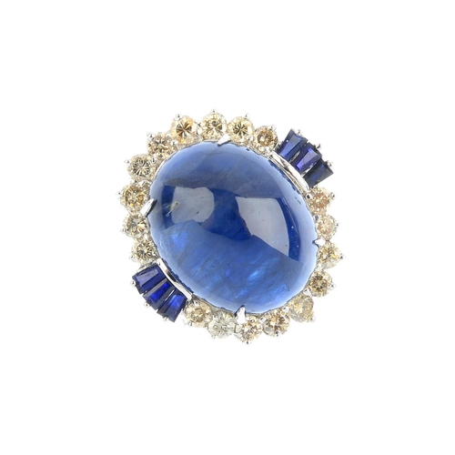 280 - A sapphire and diamond cluster ring. The oval sapphire cabochon, with brilliant-cut diamond and rect...