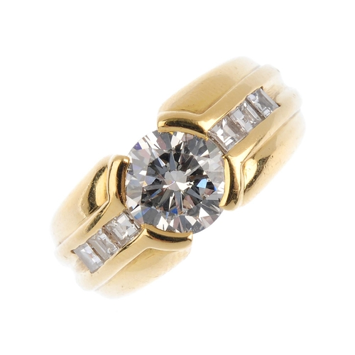 284 - A diamond single-stone ring. The brilliant-cut diamond, with square-shape diamond line sides and gro...