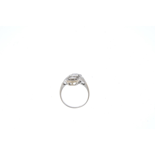 286 - A diamond dress ring. The brilliant-cut diamond collet line, with similarly-cut diamond halo sides a...