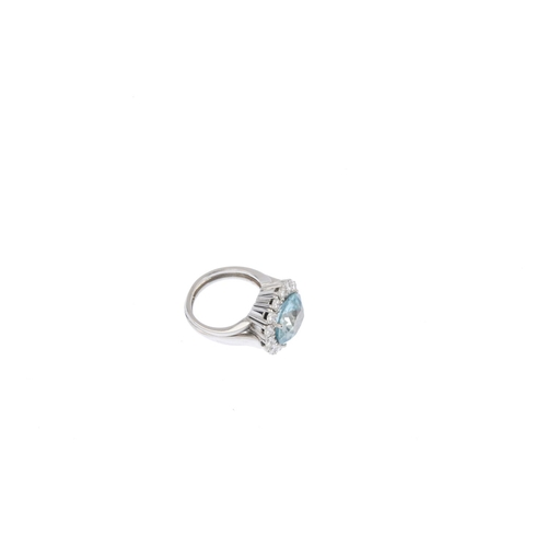 287 - A zircon and diamond cluster ring. The oval-shape zircon, with brilliant-cut diamond surround, openw...