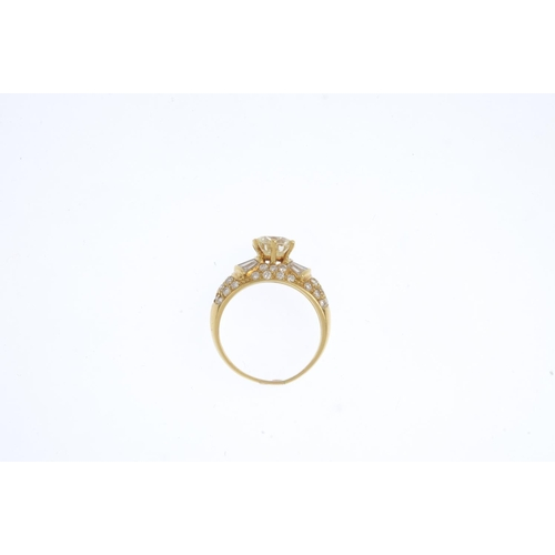 288 - A diamond single-stone ring. The brilliant-cut diamond, with tapered baguette-cut diamond shoulders ...