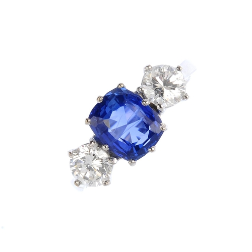 289 - A Ceylon sapphire and diamond three-stone ring. The cushion-shape sapphire, weighing 2.50cts, with b...