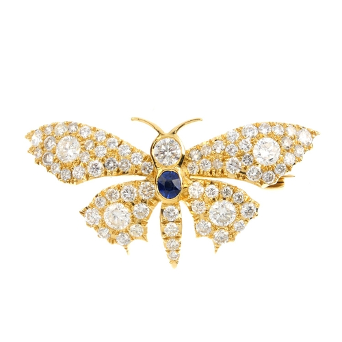 290 - A diamond and sapphire butterfly brooch. Designed as a brilliant-cut butterfly, with oval-shape sapp...