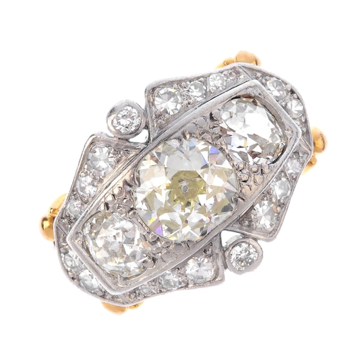 291 - A diamond three-stone dress ring. The graduated old-cut diamond line, with brilliant and single-cut ...