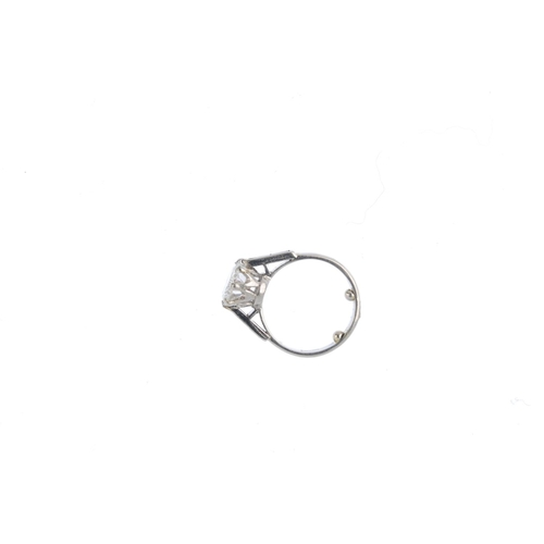 294 - A platinum diamond single-stone ring. The brilliant-cut diamond, with tapered baguette-cut diamond l...