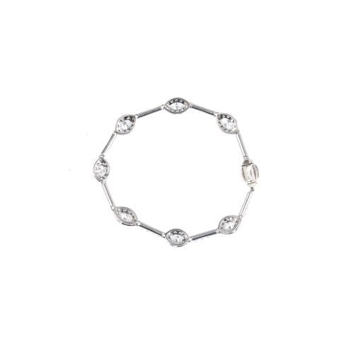 295 - A diamond bracelet. Designed as a series of marquise-shape diamond links, each with brilliant-cut di...