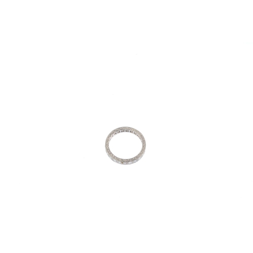3 - A diamond full eternity ring. The single-cut diamond line, with scrolling engraved sides. Estimated ...