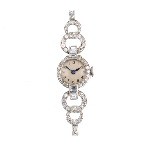 30 - A lady's diamond cocktail watch. The circular dial, with single-cut diamond bezel and vari-cut diamo...