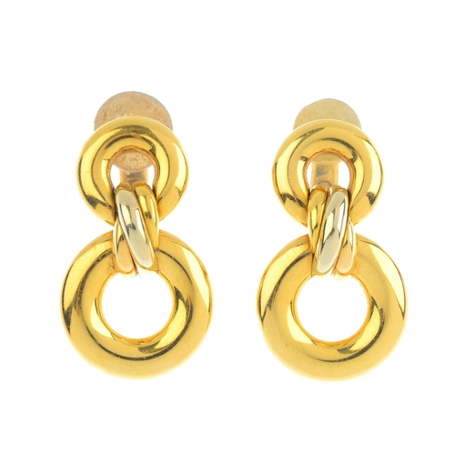 301 - CARTIER - a pair of 'Trinity' earrings. Each designed as two graduated circles, with interwoven tri-...