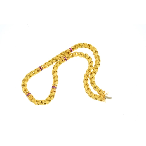 305 - A necklace. The grooved, woven-link chain, with calibre-cut synthetic ruby rondelle spacers, to the ...