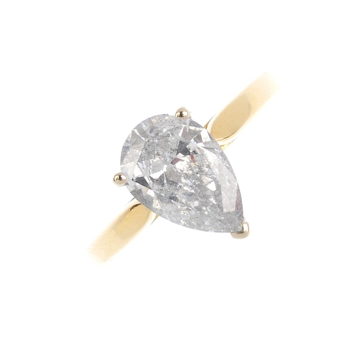 307 - An 18ct gold diamond single-stone ring. The pear-shape diamond, with plain band. Diamond weight 1.74...