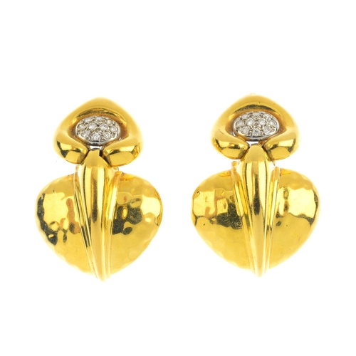 308 - A pair of diamond earrings. Each designed as a textured, stylised leaf, suspended from a pave-set di...