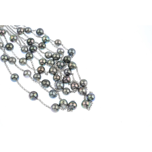 310 - A set of cultured pearl and diamond jewellery. The choker designed as a graduated series of five bel...