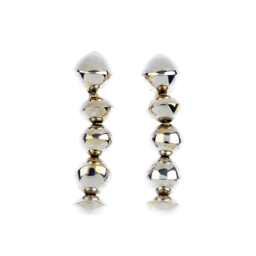 311 - A pair of earrings. Each comprising a series of vari-width beads, each tapered to an asymmetric knif...