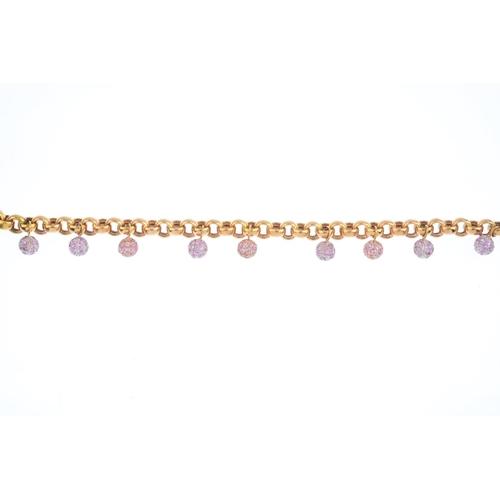 316 - A sapphire fringe bracelet. Of bi-colour design, the belcher-link chain, suspending a series of pave...