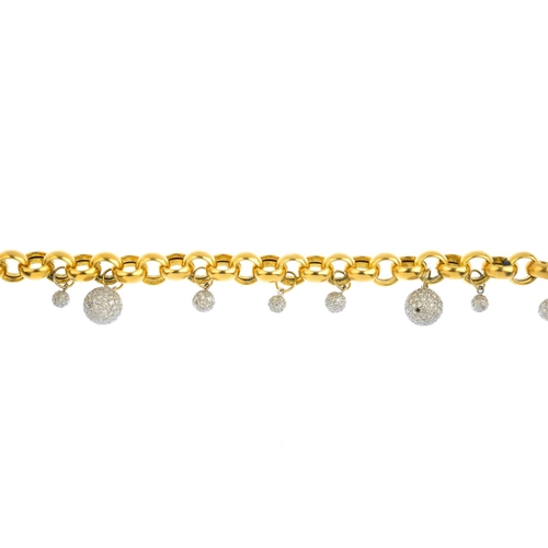 317 - A diamond fringe bracelet. Of bi-colour design, the belcher-link chain, suspending a series of pave-...