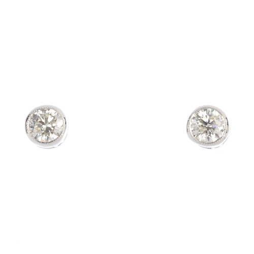 320 - A pair of brilliant-cut diamond stud earrings. Estimated total diamond weight 0.40ct, J-K colour, P1...